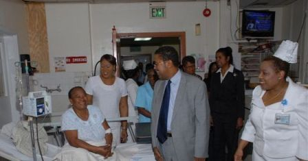Minister talks with patient